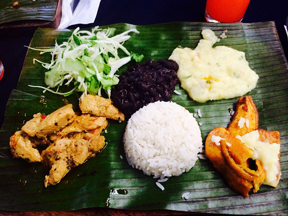Traditional Costa Rican meal with grilled chicken, black beans, white ...